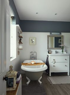 Deirdre's dark, daring cottage on the outskirts of Galway City Cottage House Designs, Cottage Homes, Ikea Units, Roll Top, Teal Chair, Banquet Seating, Chimney Breast, Tub Tile, Cottage Renovation