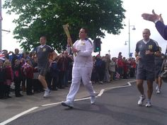 Fantastic shot of the torch bearer for Bideford! What an atmosphere!