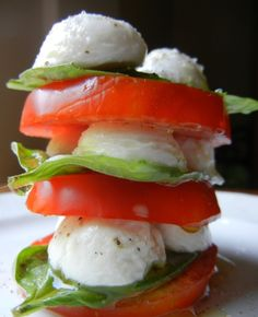 Tomato Basil & Mozzarella Stacks with JJS OWN Basil Vinaigrette....visit JJS OWN on facebook for recipe.