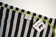 Baby swaddler. Striped boy blanket. Soft and stretchy. Size 31 by 40 inches. Colors- Black and gray with green edging. Made by lippy brand.