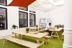 Yipit Yipit's office space reflects the company's relaxed and laidback culture. The New York City offices offer a nice combination of space for work and space for play. One unique area is the lunch/all-hands space that features park-style lunch tables where the staff can enjoy meals together on a floor of grass.