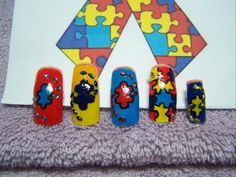 Great design :) RT @marcetuc: @Inspirationail Autism Ribbon inspired hand painted nails as my daughter is on the Autistic Spectrum