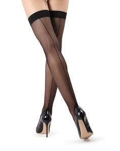 Legs for days...nights! The MeMoi killer Backseam Thigh Highs are perfect for an evening on the town. An update on a classic look, the backseam and Cuban heel are designed to raise your confidence. The silky sheer leg and sheer toe extend and elongate your legs, no matter what you're wearing. This stocking should be worn with a garter belt (not included) Want to see more? Explore the entire Women's Tights Collection by MeMoi. Thigh Highs Stockings w/ Wide comfort band Backseam and Cuban heels   Stockings Outfit, Stockings Heels, Thigh High Tights, Thigh Highs, Women's Tights, Sexy Heels, Pumps Heels, Stiletto Heels, Nylons