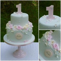 "This pastel blue two tier design featured a crown of icing roses and blossoms, dainty piped dots and a hand-cut number one – inspired by a fairy garden for a very special first birthday. Follow us on Facebook: """":http://www.facebook.com/TiersTiaras"