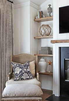 Bookshelf Decorating Ideas. love the natural wood shelves with matching mantel