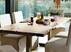 Embrace the harvest season and dine at a rustic, handmade table. An industrial iron base contrasts the raw-edge acacia wood tabletop. | CDI raw-edge dining table | SHOP NOW |