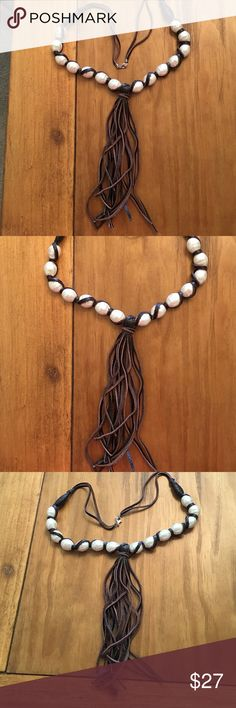 "Necklace Leather and Pearls with leather tassels. Necklace Leather and Pearls with leather tassels.  Approximately 29"" with tassel that is 7"" long.  Never been worn. Very unique. Jewelry Necklaces"