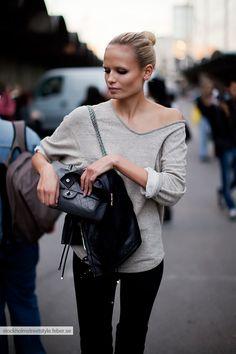 Natasha Poly (neutrals, basics, black pants, grey knit sweater, black leather purse)