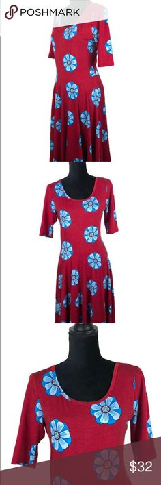 """Lularoe Simply Comfortable Nicole Dress Floral L - Size: Large - Material: 94% Spun Polyester, 6% Spandex  - Condition: Like New  - Color: Red with Blue Flowers - Pockets: No - Lining: No  *Measurements(Taken Laying Flat): Pit-to-Pit: 17.5"""" Length: 39"""" LuLaRoe Dresses Midi"""