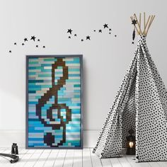 Brighten up your room with this beautifully crafted wall art featuring a treble clef on a background of blue and turquoise. Perfect for all music lovers!