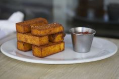 Crispy Polenta Fries. Upgrade your game day watch party with these perfectly crispy-creamy fries from Michael's Genuine Pub onboard Anthem of the Seas.