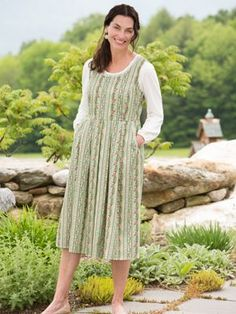 Lanz Of Salzburg Vienna jumper for women is made with 100 percent cotton. This womens Lanz jumper features scalloped lace trim along the scoop neck and front pockets, flattering seaming along the bodice, and a back zipper.