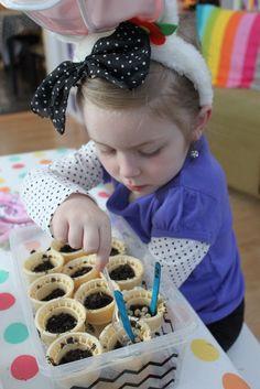 spring pre k planting seeds in ice-cream cones