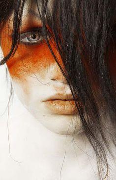love this tomato + ivory + brunette look. so blade runner.