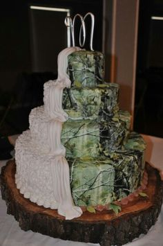 Camo wedding cake!  Just in case you only want your guests to see half of the cake, so you can match the rest with your surroundings and later use it to bait deer from your honeymoon tree stand!