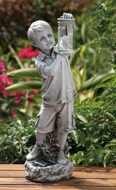 "Boy Holding Firefly Jar Solar Garden Statue: Statue measures 18.25""H x 6.5""W x 6""D. Made of a resin stone mix. Weighs approximately 3.7 lbs."