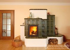A tiled stove generally describes a fireplace that surrounds the surrounding tiles . Fireplace Tv Wall, Fireplace Remodel, Fireplace Ideas, Wood Burner Stove, Stair Shelves, Herd, Outdoor Cooking, Tiles, Sweet Home