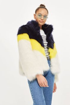 Make a retro-inspired statement with our faux fur coat in yellow, black and white. We're styling it high-waisted jeans for a dressed down take on glamour.