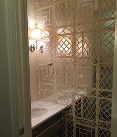 Quadrille Lyford Trellis wallpaper powder room Circa Lighting Camille Sconce