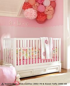 girl's room...cool storage under crib