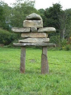 """Inukshuk...means ""in the likeness of a human"" in the Inuit language. They are monuments made of unworked stones that are used by the Inuit for communication and survival. The traditional meaning of the inukshuk is ""Someone was here"" or ""You are on the right path."""