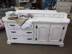 SOLD - Vintage dresser buffet with 11 drawers - crisp white painted, lightly distressed & clear wax finish - New hardware. ***** In Booth D8 at Main Street Antique Mall 7260 E Main St (east of Power RD on MAIN STREET) Mesa Az 85207 **** Open 7 days a week 10:00AM-5:30PM **** Call for more information 480 924 1122 **** We Accept cash, debit, VISA, Mastercard, Discover or American Express