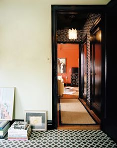 Black walls and trim work well in high-traffic hallways and transitional spaces, creating a dramatic segue between rooms.