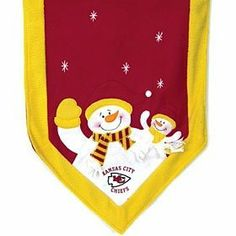 Kansas City Chiefs 72''X15'' Snowman Table Runner by Hall of Fame Memorabilia. $45.95. Decorate Your Table With This Snowman Table Runner. 72'' Long By 15'' Wide, This Plush Table Runner Features A Snowman Parent And Child At Each End Dressed In Your Favorite Team's Colors, Along With The Team Logo And Embroidered Stars. Add The Table Top Snowman Family To Complete The Look!Images Shown May Differ From The Actual Product.