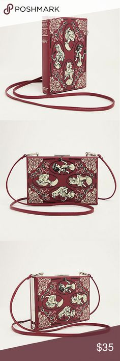 "Torrid Disney princess storybook clutch Burgundy faux leather snap top clutch resembles a storybook, featuring your favorite fairy tale Disney Princesses. The clutch can convert to a crossbody with a removable strap. Multiple card slots and an interior zip pocket lend versatility.  6"" wide X 9"" tall X 1.25"" deep  59"" crossbody strap  *color is more burgundy than pictures show...very rich shade. torrid Bags Clutches & Wristlets"