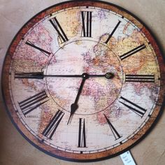 world map clock...perfect for M's room so she can't use 'I didn't know what time it is' excuse for school mornings. lol