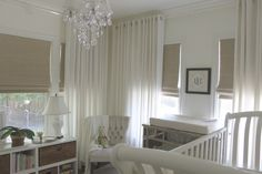 Lucite Curtain Rods Round acrylic rods and finials blend seamlessly and visually add height in a nursery. via House of Wentworth