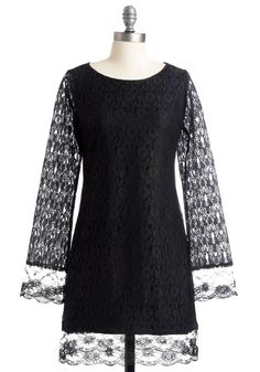 Weakness for all things lace, even if this one has a higher neck than I usually wear...