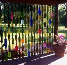 wine bottle wall back yard ideas. Perfect way to have block a bit of sun.