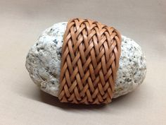 Paper weight. Gaucho knot two passes