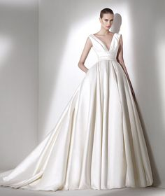 "Elie by Elie Saab for Pronovias..... So I would never wear this or have ""that kind"" or wedding but this is beautiful"