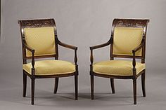 History of french furniture: The Directoire style; columnar front legs, splayed back legs, non-recessed arms, ebonized finish