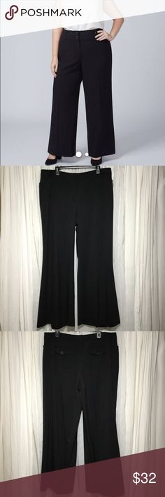 Lane Bryant wide leg - palazzo Planck pants SZ 18 The model is not wearing the exact parent but it is a similar style. These pants have two front pockets, two packets in back with flaps and buttons. Hooks and zips up front. Five belt loops. Fabric has a slight black on black pinstripe, Very hard to notice.  64% polyester 34% rayon 2% spandex Waist 20 inches Rise 11.5 inches Inseam 31.5 inches  These pants are in great condition! The perfect black pant for all year long. Thanks for visiting…