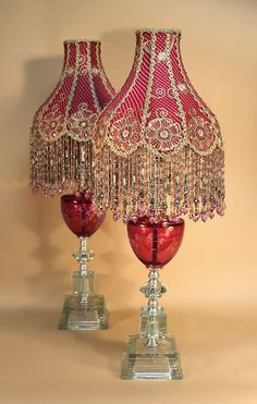 cranberry red and clear glass lamps. Petticoat shaped shades with indian silk embroidery. Chandeliers, Chandelier Lamp, Lantern Lamp, Old Lamps, Antique Lamps, Shabi Chic, Clear Glass Lamps, Victorian Lamps, Victorian Lamp Shades