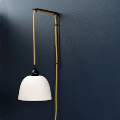 Ribbed Pendant Sconce Idea for beside bed - make your own from exposed bulbs and colorful cords.