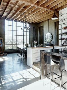 Kitchen space with wooden ceiling