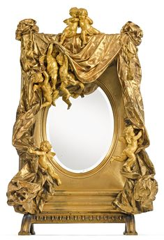 Gustave Doré French, 1832 - 1883 A large and rare gilt bronze table mirror Paris, circa most probably cast by M. Bernoux original bevel glass mirror, signed GVE DORE height 40 in. width 25 in. depth 11 in. French Furniture, Antique Furniture, Furniture Design, Decoration Baroque, Gustave Dore, Antique Frames, Through The Looking Glass, Objet D'art, Beveled Glass