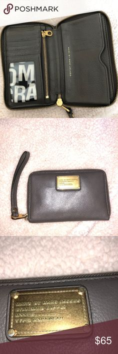 """MARC BY MARC JACOBS CLUTCH WALLET """"WORKWEAR"""" BROWN ♡MARC JACOBS clutch wallet wristlet. """"Workwear"""" style. Brown with gold detailing and inside as a black and white Marc design ♡ Amazing condition! Id holder, 6 card holders, zip up change pocket, cash pocket, and cute design! Signs of wear are shown in pictures, just a small stain under the plastic in the ID holder ♡Stylish and useful! I'd keep this because it's so amazing but I have too many wallets!  ❗️Always open to offers, ❗️ ‼️Bundle to…"""