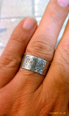 finger print ring by DeMichels on Etsy, $200.00 we are doing some version of this.