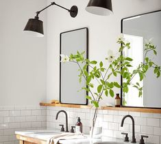**BATHROOM DESIGN TIP** Symmetry is essential when creating a harmonious and classic bath. We are partial to two mirrors rather than a single large one over the vanity. Pottery Barn's Vintage Fixed Mirror With its slim, rounded frame and beveled glass, th Modern Farmhouse Bathroom, Modern Powder Rooms, Diy Bathroom, Bathroom Flooring, Bathroom Interior, Bathroom Decor, Bathrooms Remodel, Best Kitchen Layout, Round Mirror Bathroom