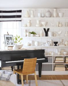 A vast collection of pottery is on display in this living room.