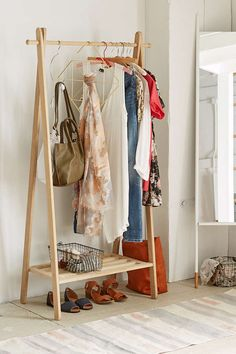 Wooden Clothing Rack - Urban Outfitters i ld need like ten of these lol