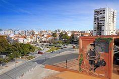 """O """"Rapaz dos Pássaros"""", um graffiti pintado pelo português Sérgio Odeith, foi eleito um dos 24 melhores murais do mundo em 2014."""
