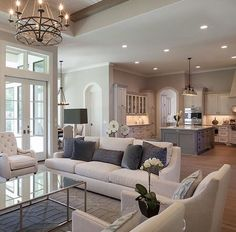 Beautiful living room with white kitchen