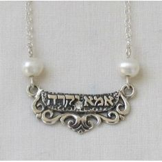 "Perfect for Mother's day. Sterling 16"" chain, sterling beautiful mother in Hebrew plaque measures approximately 1"", flanked by pearls. MADE IN ISRAEL."