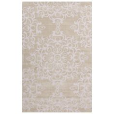 Anchor your living room seating group or define space in the den with this hand-tufted rug, featuring a scrolling medallion motif for eye-catching style.